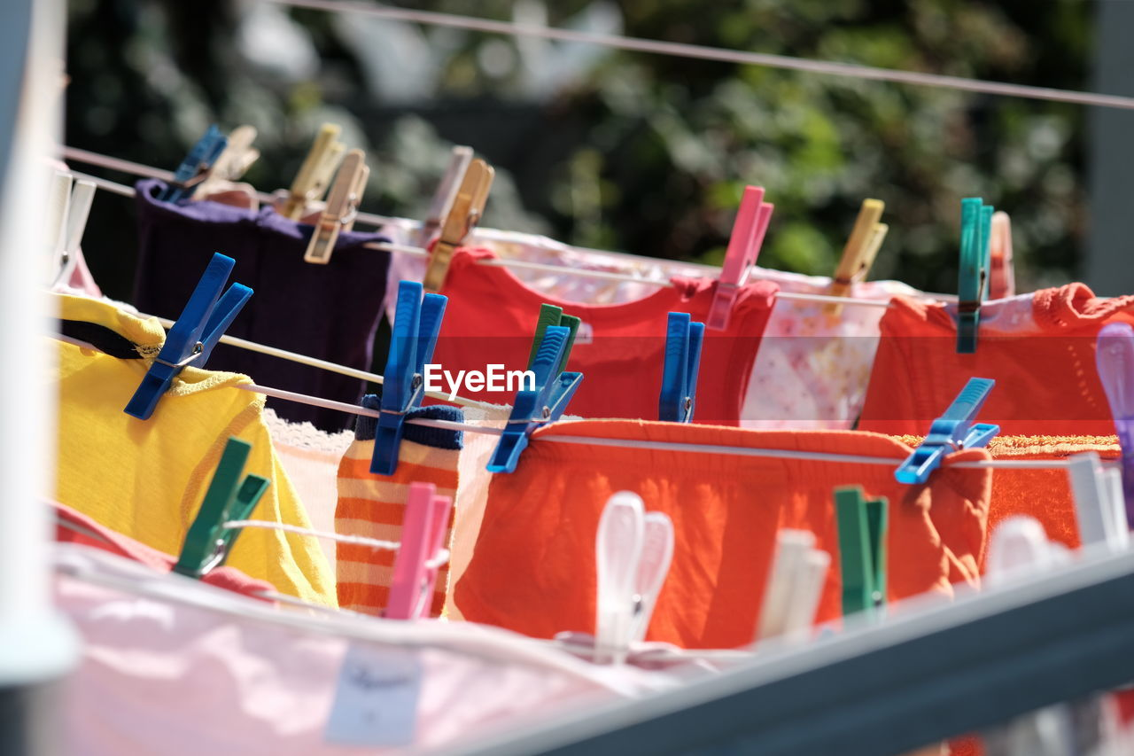clothesline, clothespin, no people, protection, outdoors, day, hanging, large group of objects, close-up, drying, nature