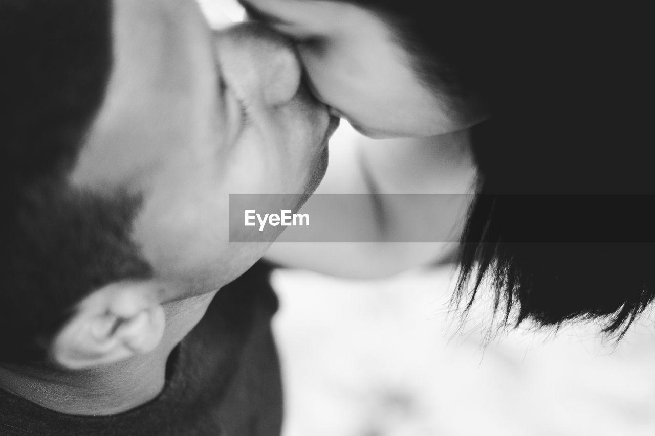 High Angle View Of Couple Kissing