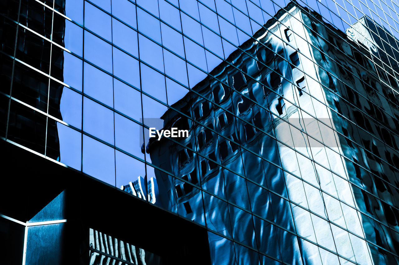 Low Angle View Of Office Building With Reflection