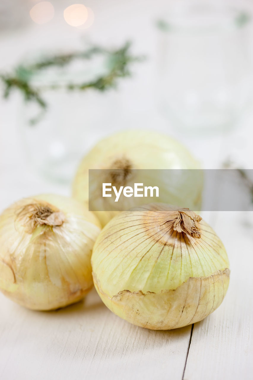 Close-up of onions on table