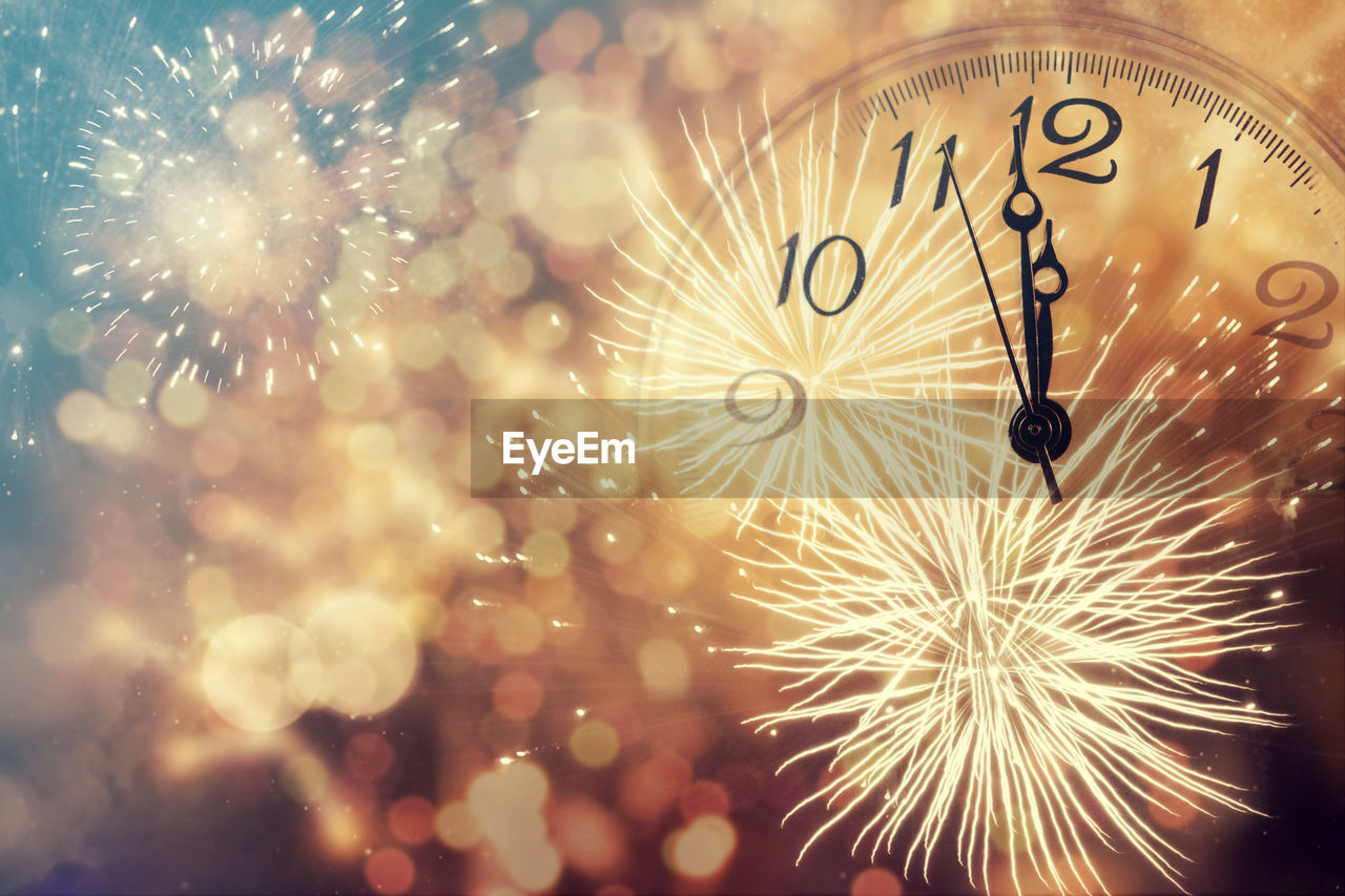time, clock, night, celebration, illuminated, no people, event, motion, firework display, new year's eve, celebration event, firework, arts culture and entertainment, number, long exposure, holiday - event, holiday, exploding, midnight, minute hand, clock face