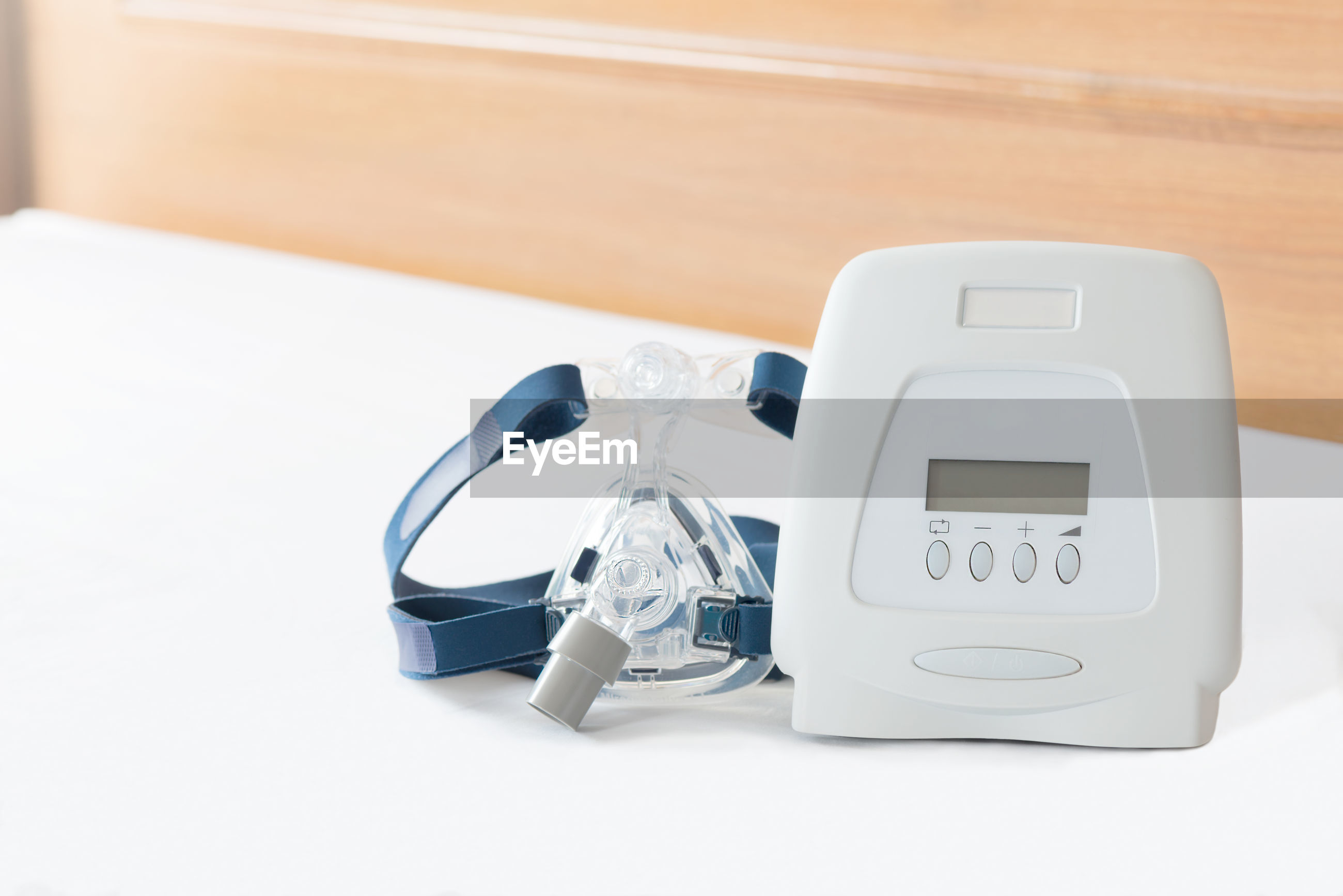 Close-up of medical equipment on white table