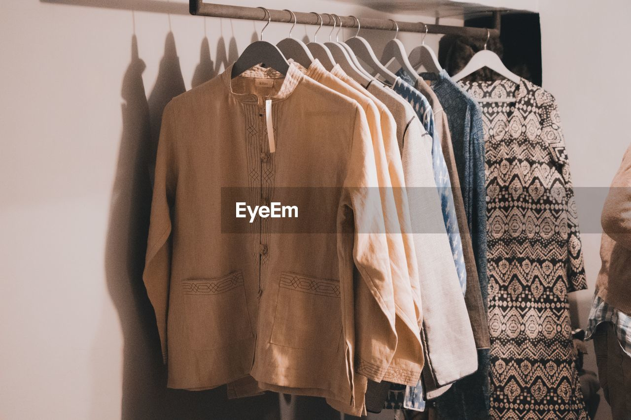clothing, hanging, coathanger, choice, rack, fashion, variation, indoors, no people, clothes rack, in a row, retail, store, still life, textile, shopping, large group of objects, side by side, business, collection, sale, retail display, consumerism, blouse