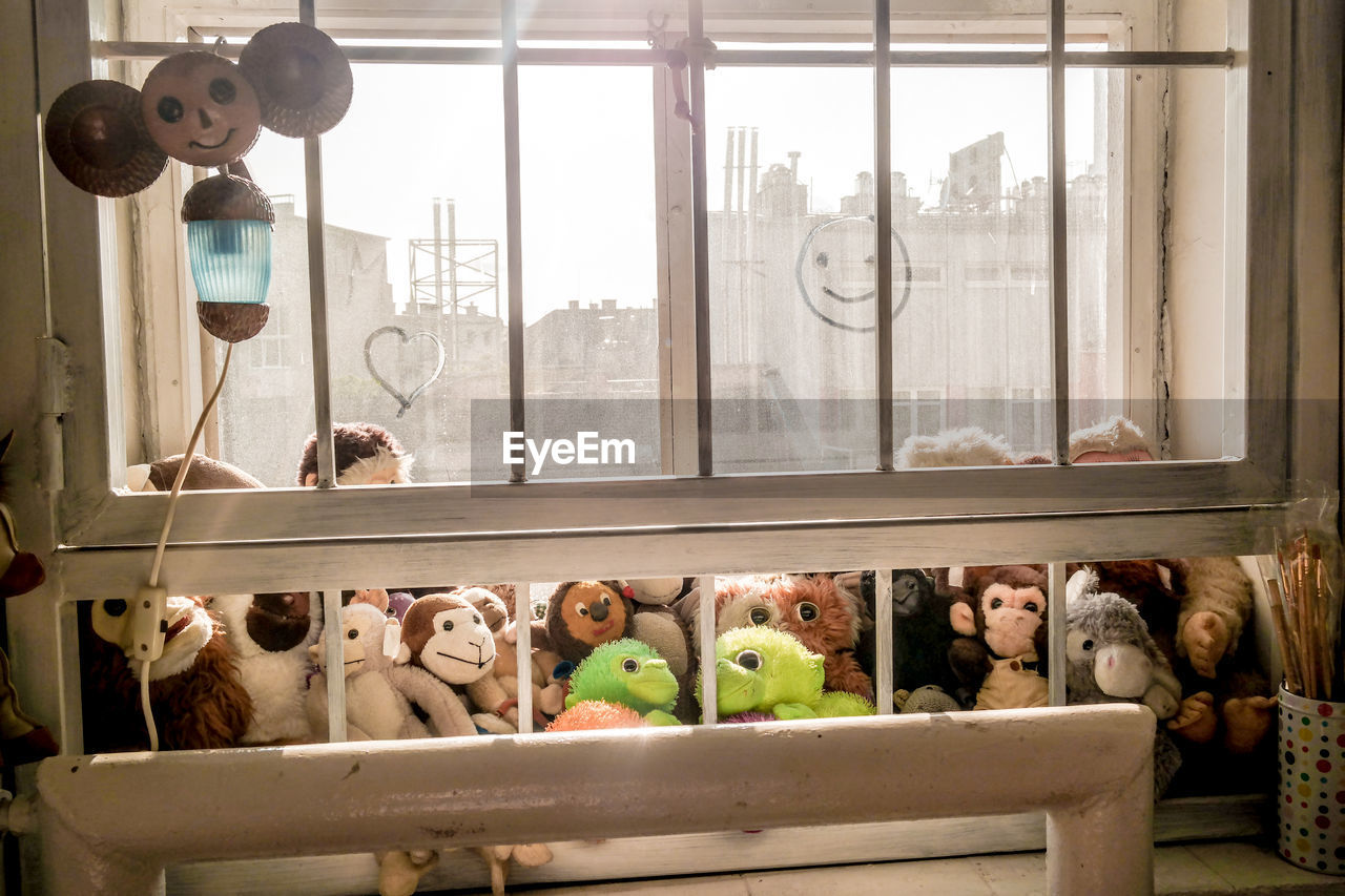 High angle view of stuffed monkeys on window sill
