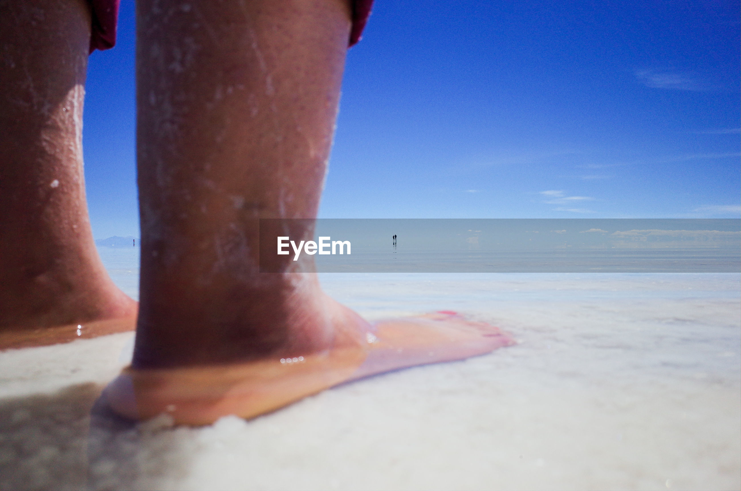 human body part, sea, beach, human leg, water, land, body part, lifestyles, sky, real people, nature, low section, day, leisure activity, one person, barefoot, sand, trip, outdoors, horizon over water, human foot, human limb