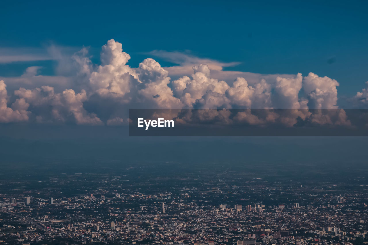 Aerial View Of City Against Sky