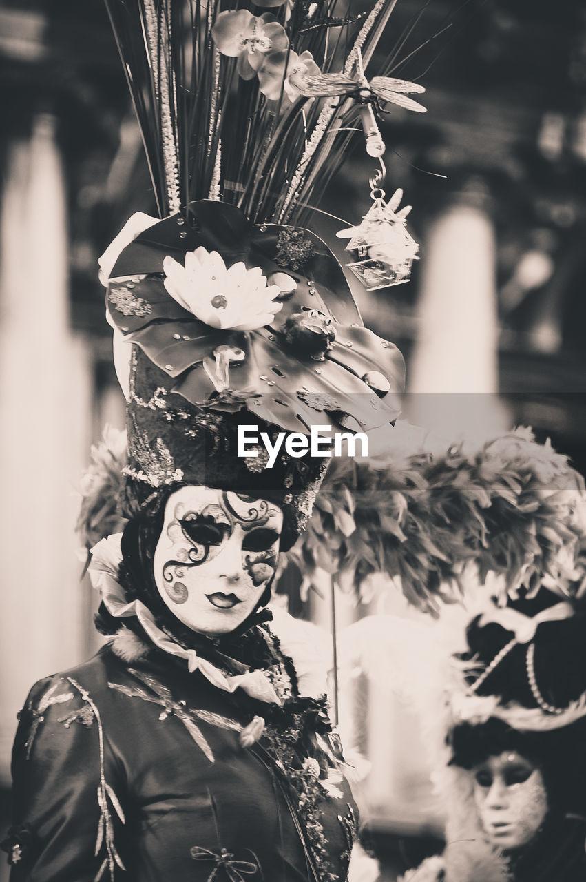 Woman wearing venetian mask at carnival of venice