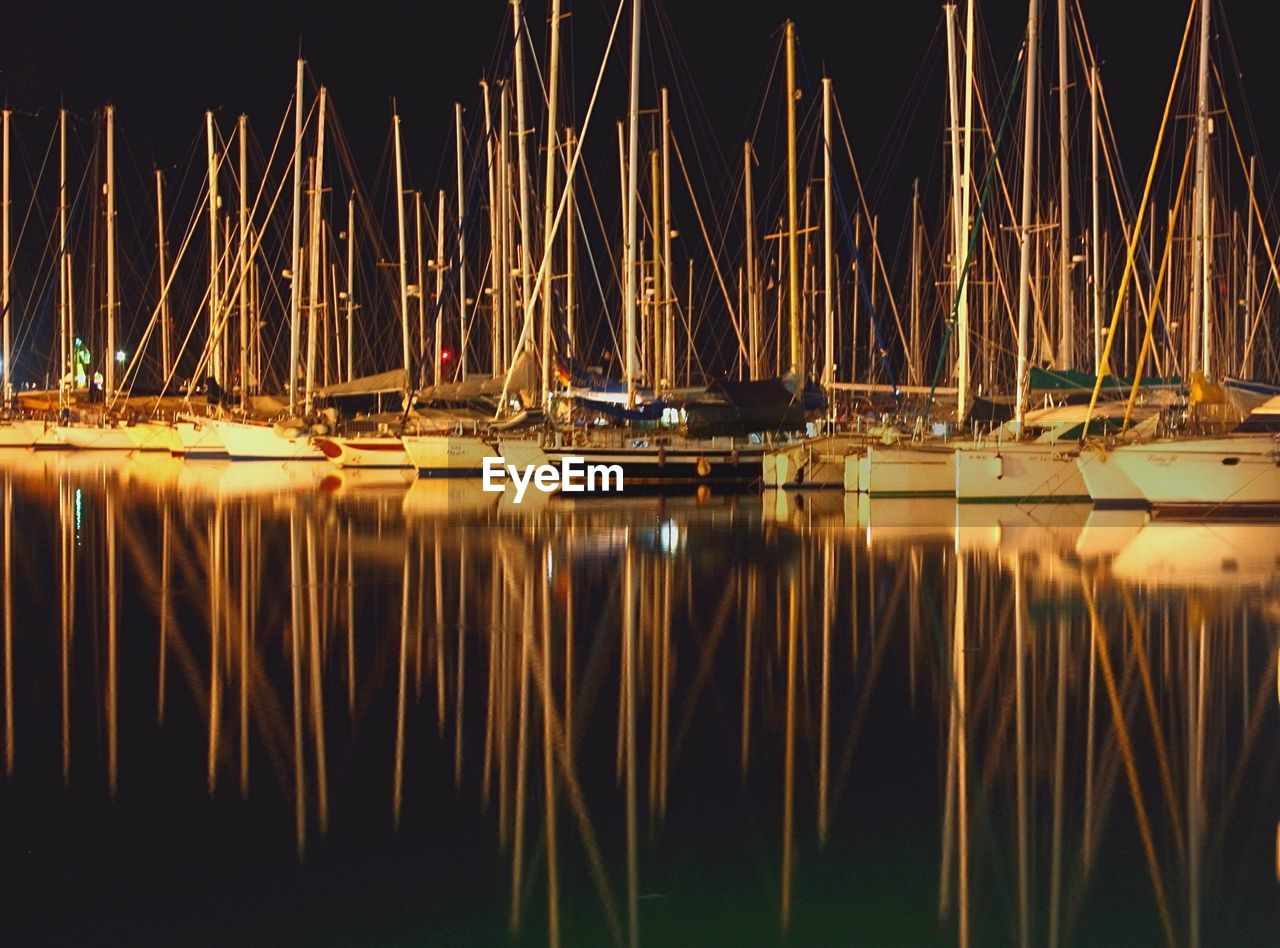 REFLECTION OF SAILBOATS IN WATER