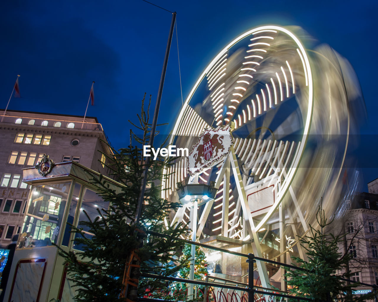 building exterior, architecture, built structure, night, outdoors, no people, low angle view, illuminated, tree, amusement park, sky, arts culture and entertainment, amusement park ride