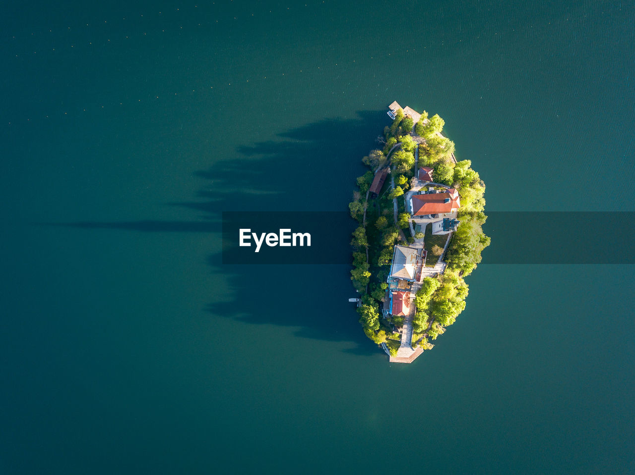 water, waterfront, nature, sea, nautical vessel, reflection, outdoors, no people, transportation, day, beauty in nature, high angle view, floating, tranquility, mode of transportation, blue, floating on water, directly above