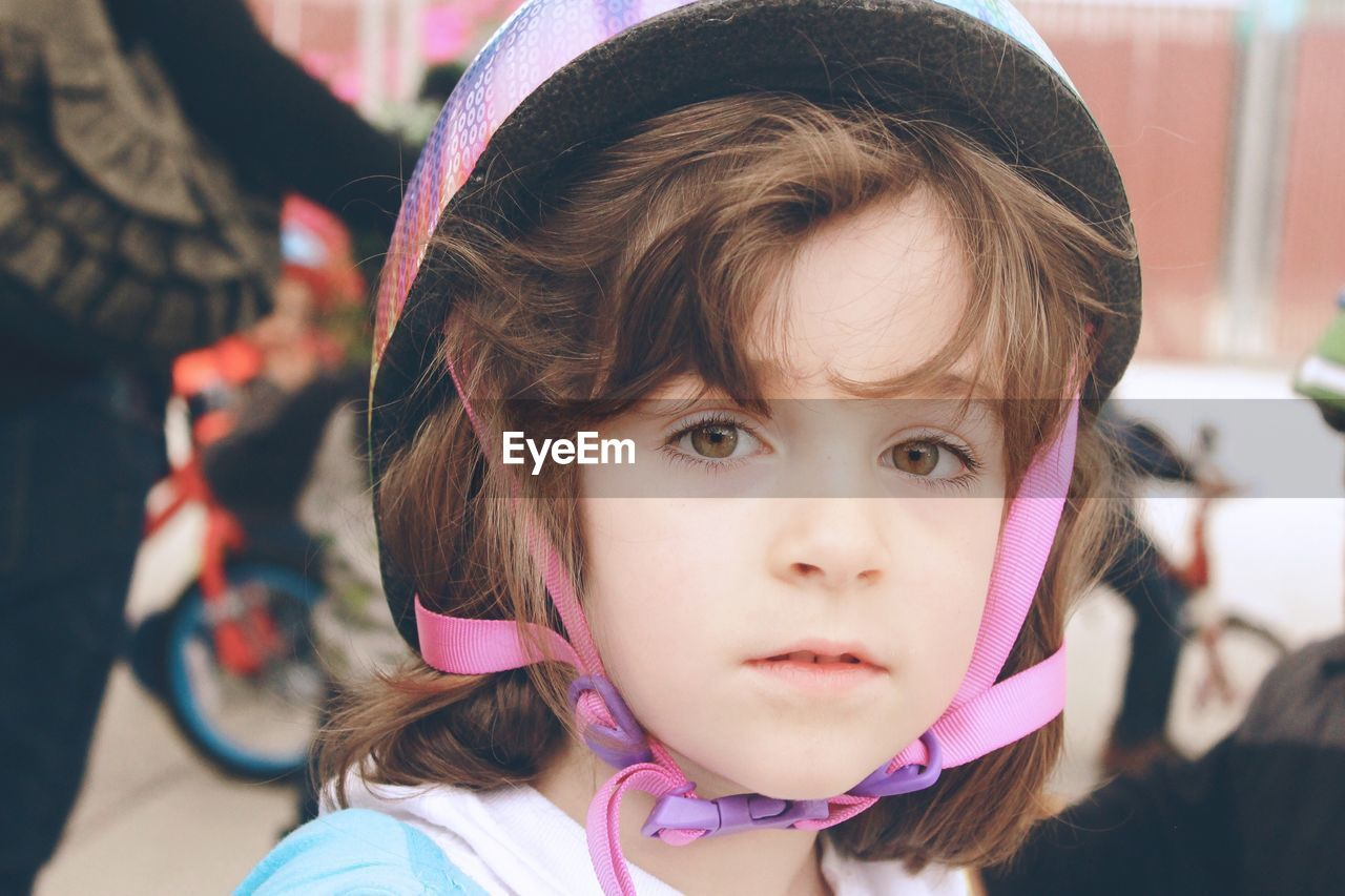 Close-Up Portrait Of Girl Wearing Cycling Helmet
