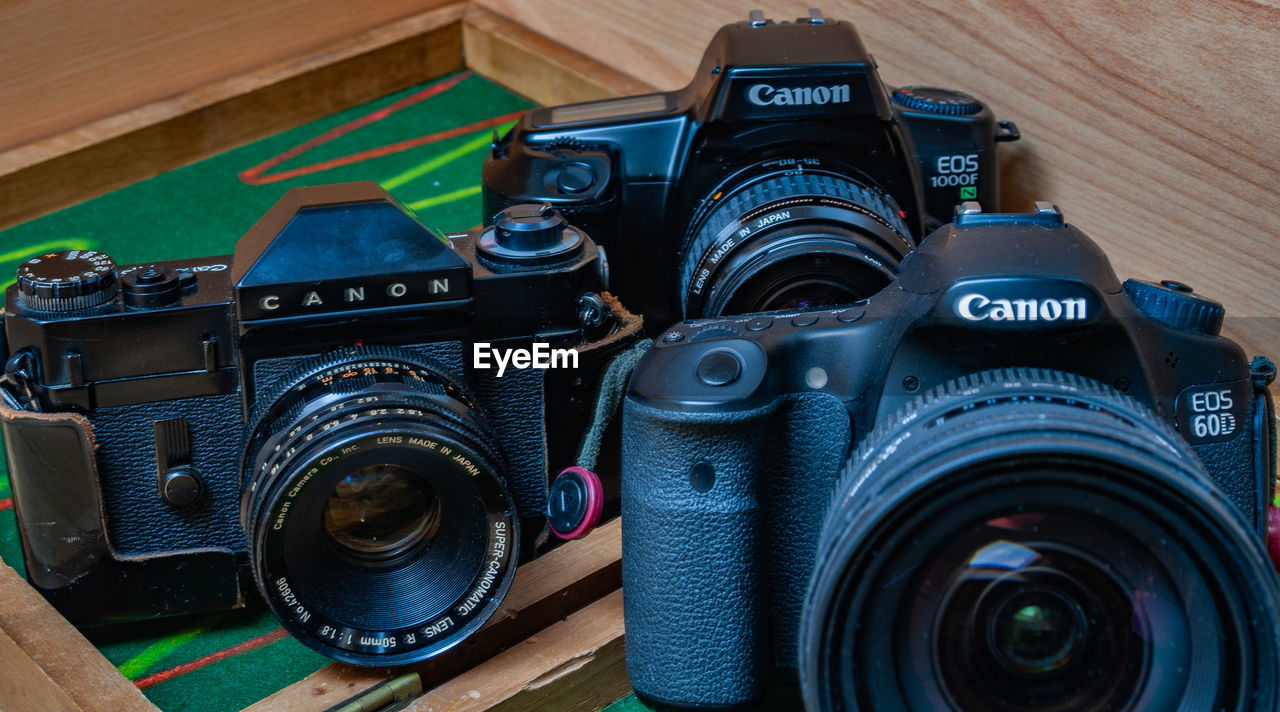 photography themes, camera - photographic equipment, photographic equipment, technology, camera, close-up, lens - optical instrument, indoors, no people, digital camera, still life, retro styled, photographing, activity, table, black color, vintage, modern, lens - eye, slr camera, home video camera