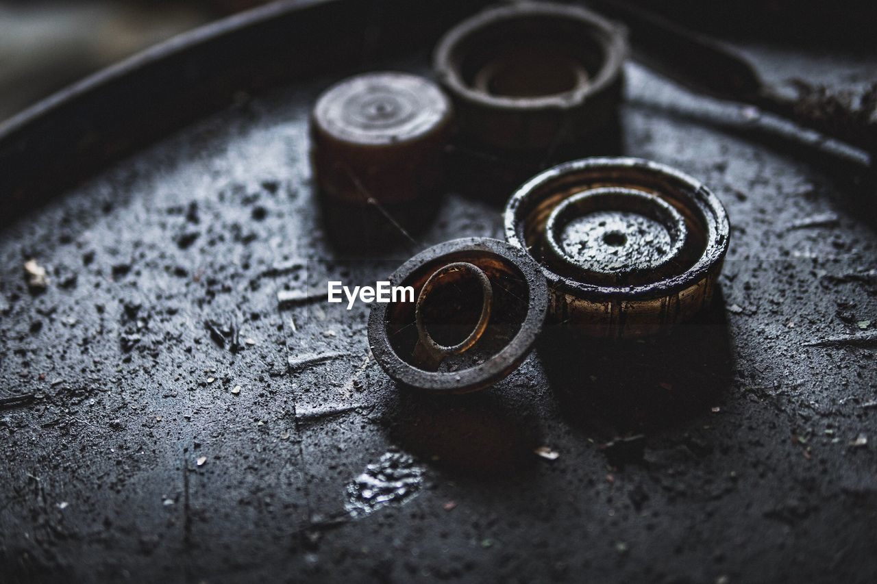 selective focus, close-up, metal, no people, indoors, still life, shape, equipment, high angle view, work tool, geometric shape, circle, machinery, day, rusty, food and drink, industry, table, bolt, silver colored