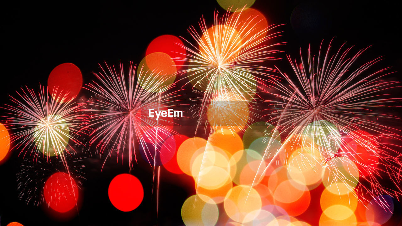 celebration, illuminated, firework, event, motion, night, arts culture and entertainment, firework display, glowing, exploding, long exposure, multi colored, blurred motion, no people, firework - man made object, sparks, red, nature, low angle view, light, sparkler, new year's eve