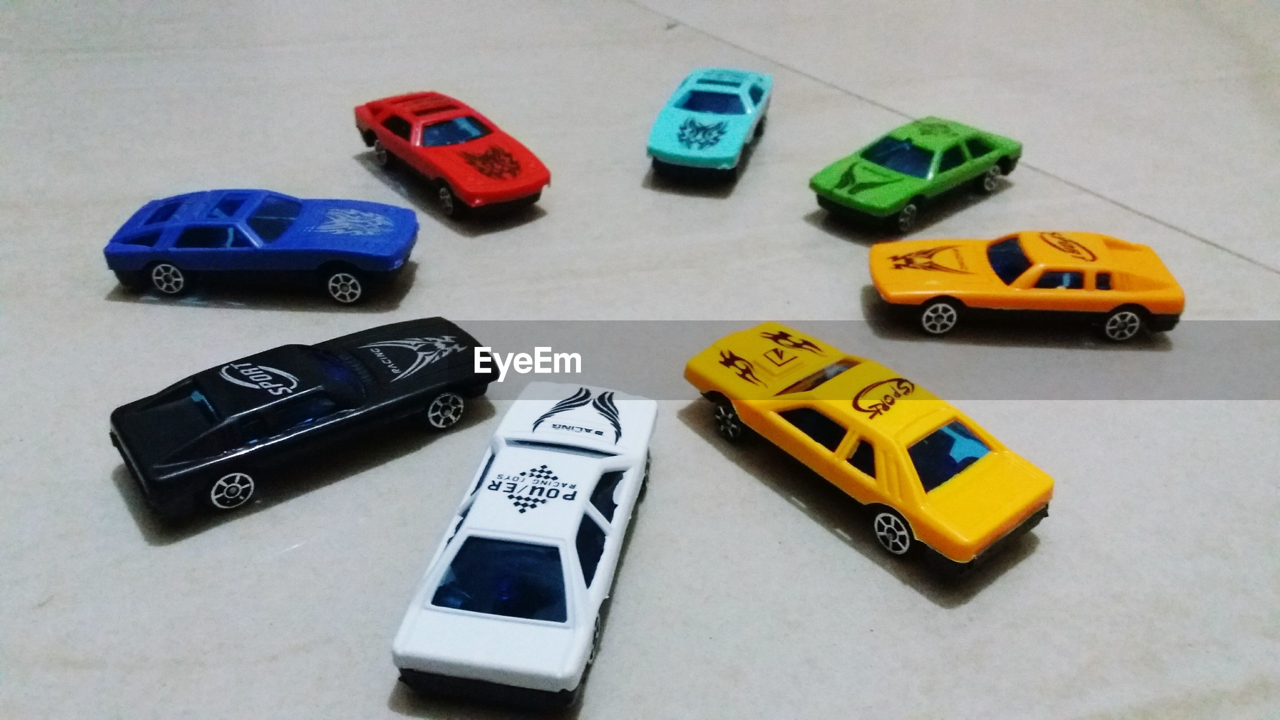 High angle view of toy cars on table