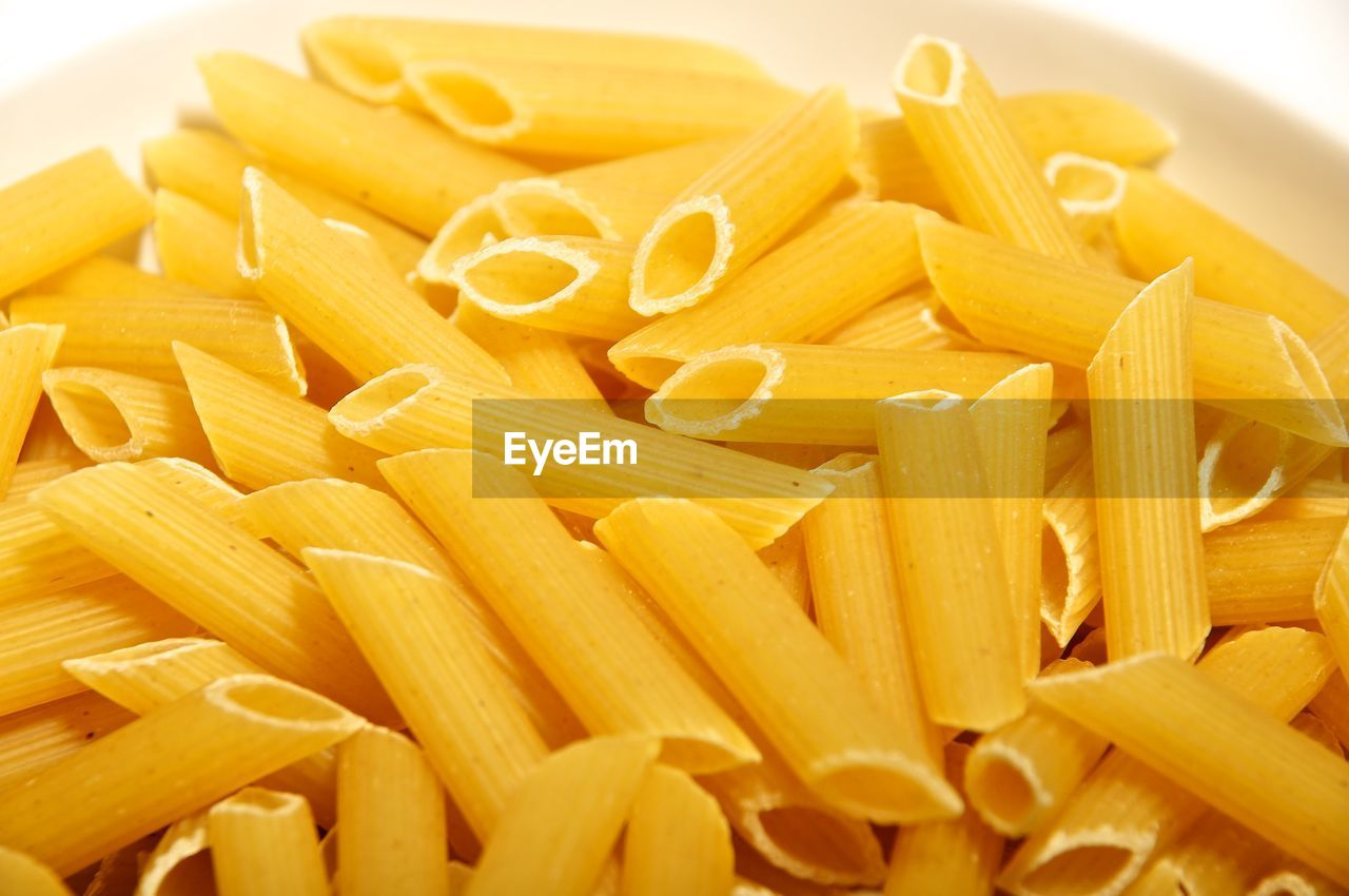 pasta, italian food, food and drink, food, freshness, raw food, still life, indoors, close-up, penne, large group of objects, wellbeing, healthy eating, no people, yellow, high angle view, full frame, backgrounds, spaghetti, macaroni, snack, vegetarian food