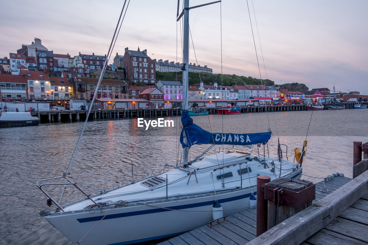 nautical vessel, water, transportation, mode of transportation, moored, architecture, sky, building exterior, nature, sailboat, built structure, harbor, mast, cloud - sky, no people, pole, sea, day, outdoors, yacht, passenger craft, marina