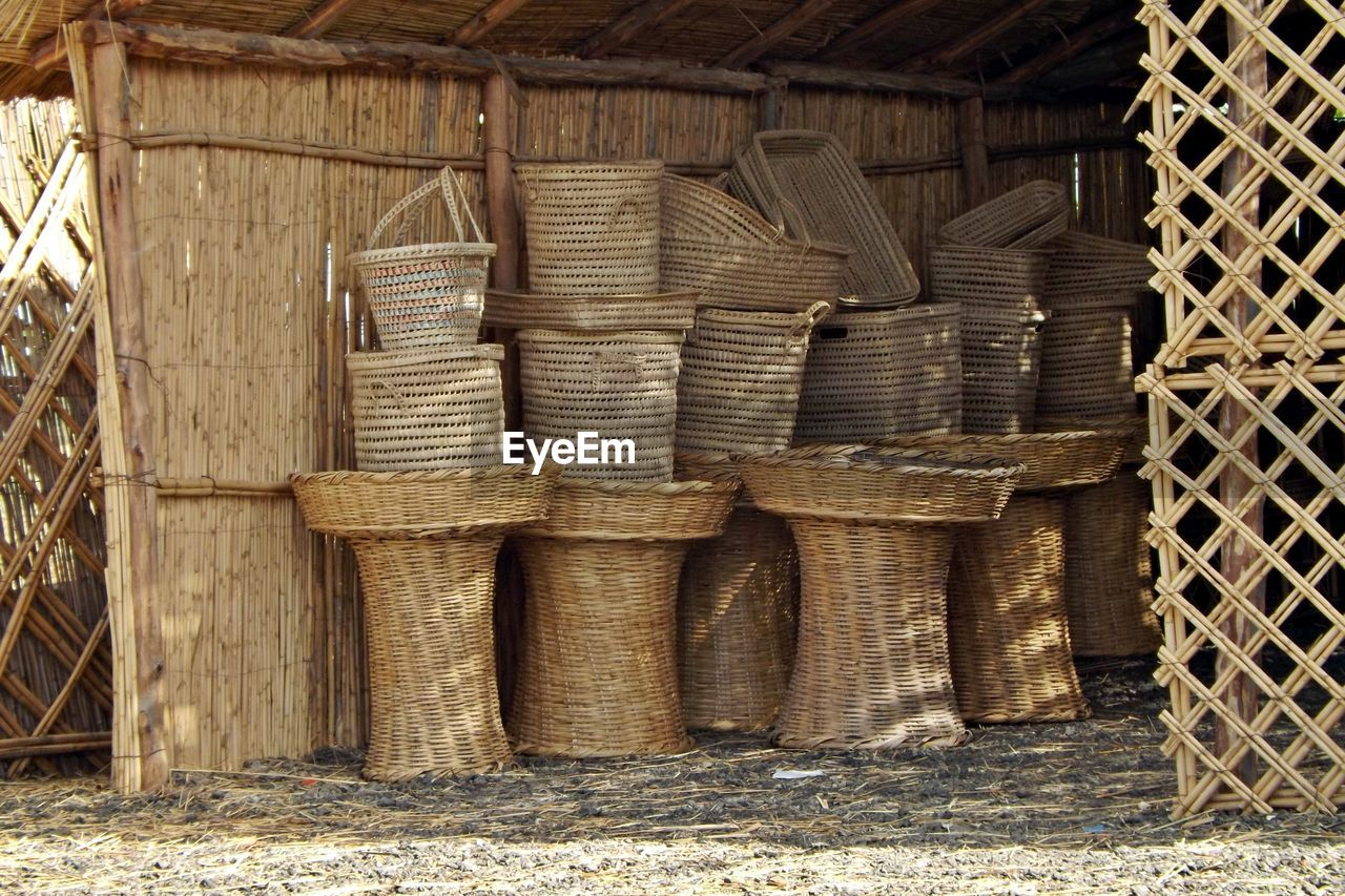 container, wicker, no people, day, large group of objects, basket, wood - material, stack, pattern, architecture, outdoors, brown, built structure, building, abundance, craft, nature, close-up, old, wheel