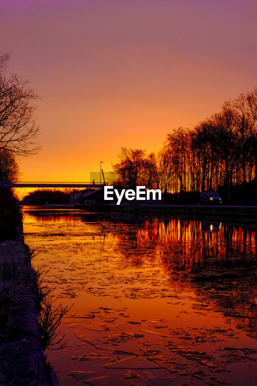 sunset, water, sky, beauty in nature, scenics - nature, orange color, tranquil scene, tree, tranquility, reflection, lake, nature, plant, no people, idyllic, silhouette, waterfront, non-urban scene, cloud - sky, outdoors, romantic sky