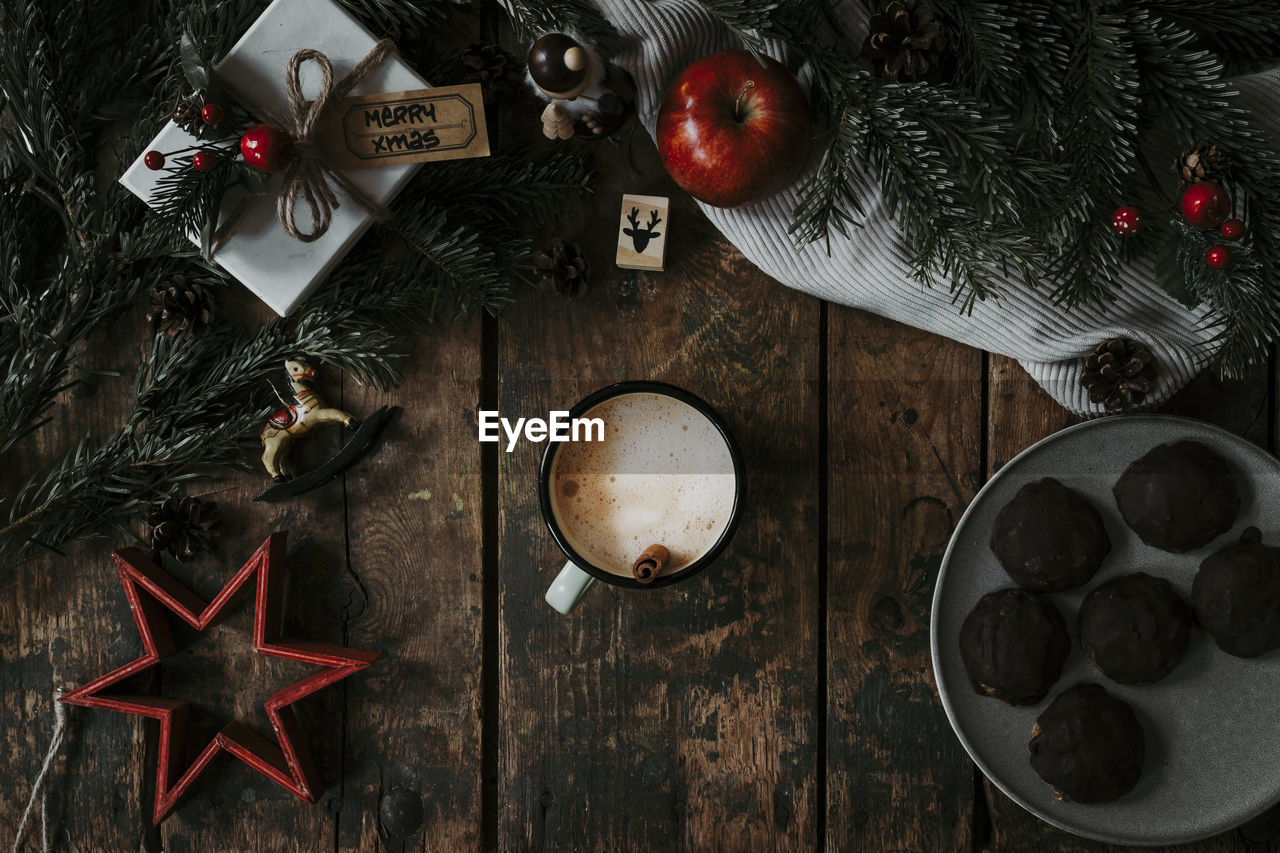 table, christmas, food and drink, holiday, christmas tree, christmas decoration, still life, indoors, decoration, christmas ornament, celebration, food, directly above, no people, high angle view, freshness, wood - material, star shape, tree