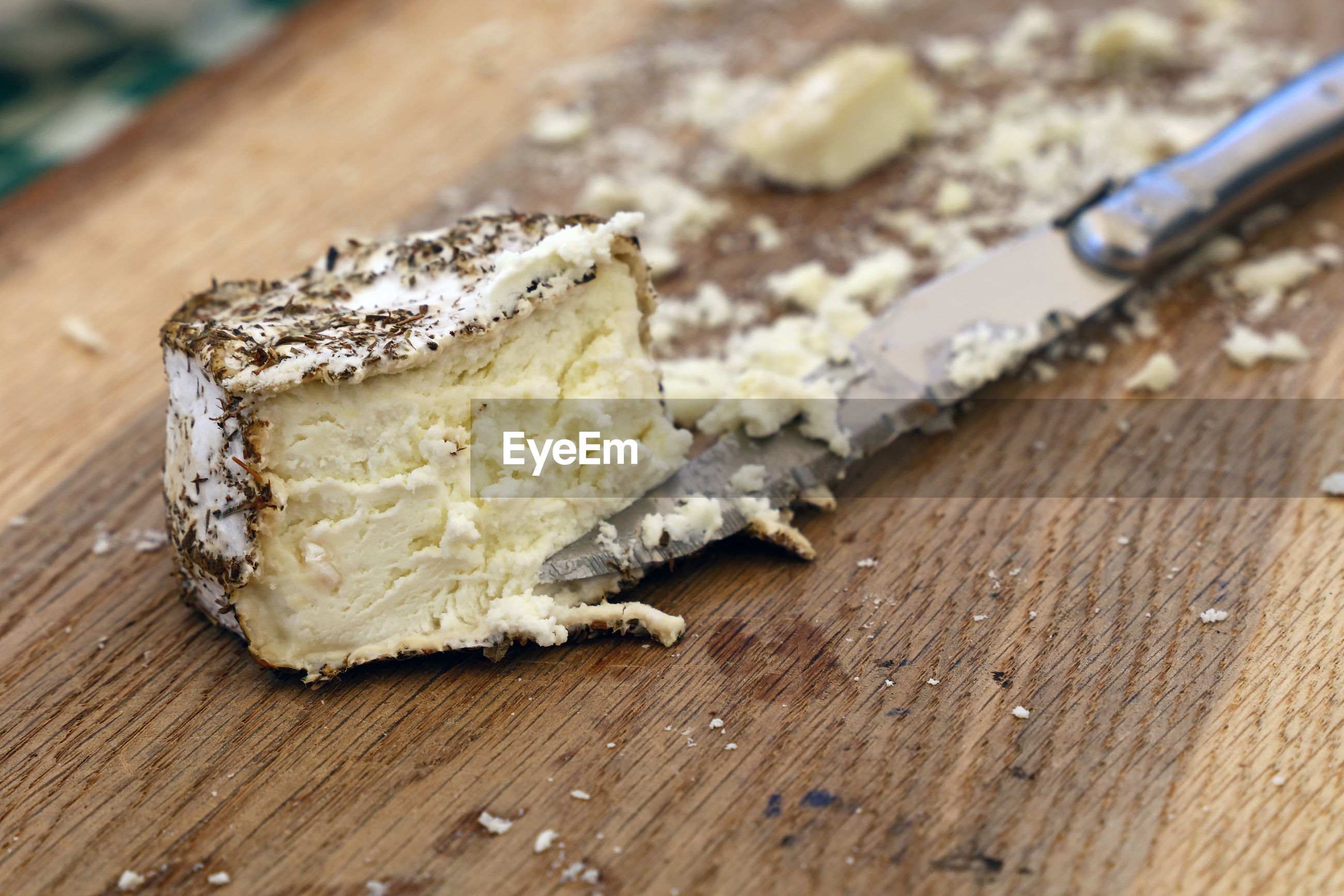 Close-up of cheese on cutting board