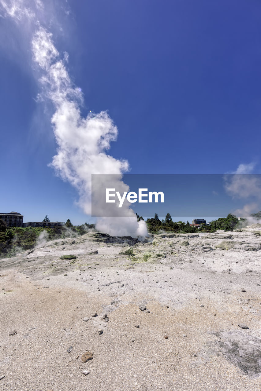 smoke - physical structure, sky, steam, land, geology, day, beauty in nature, geyser, landscape, environment, scenics - nature, cloud - sky, physical geography, hot spring, non-urban scene, nature, power in nature, no people, heat - temperature, blue, emitting, outdoors, air pollution, pollution, arid climate