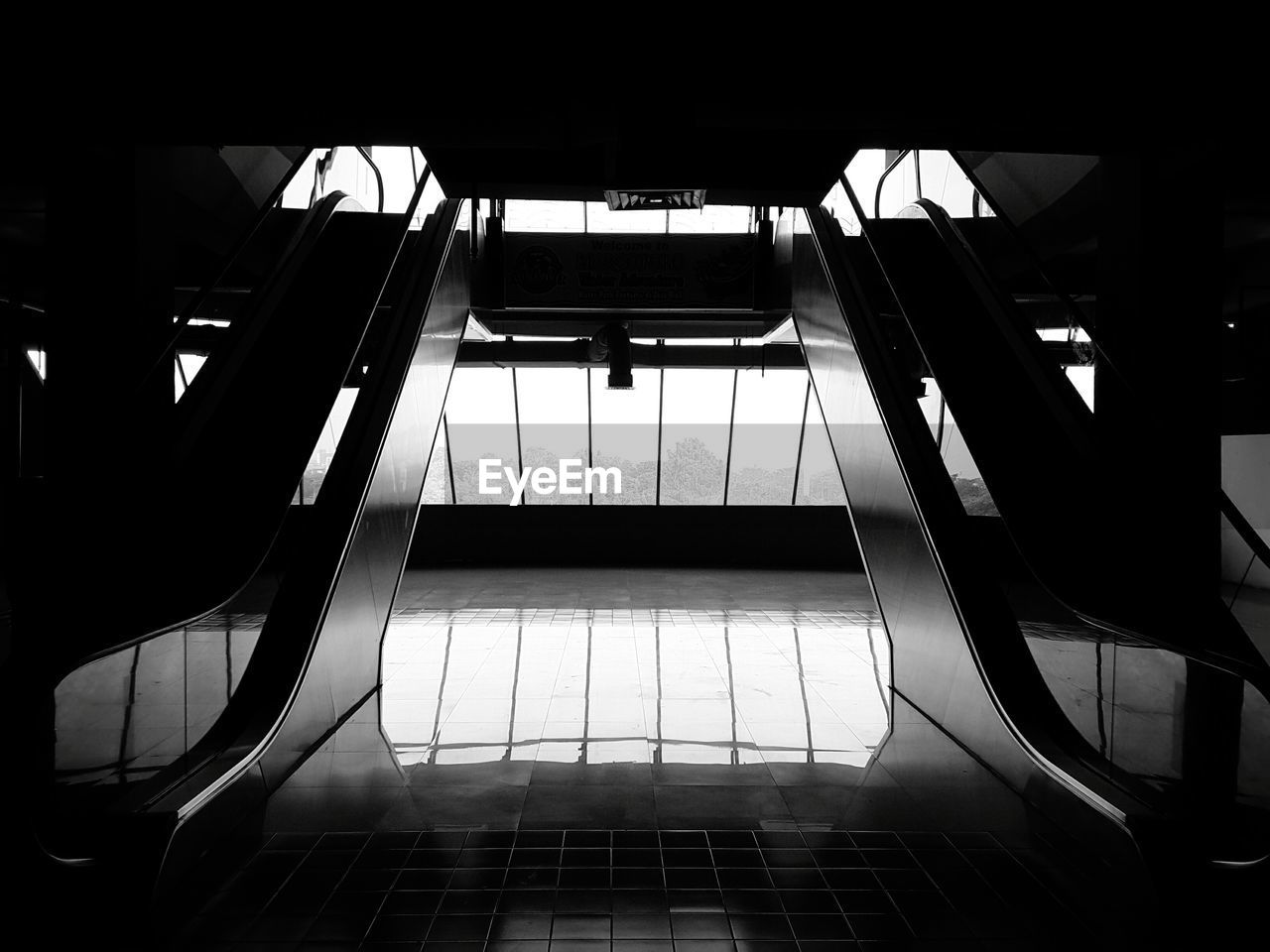 architecture, built structure, modern, indoors, no people, low angle view, staircase, escalator, railing, convenience, transportation, day, steps and staircases, metal, empty, connection, building, technology, glass - material, ceiling