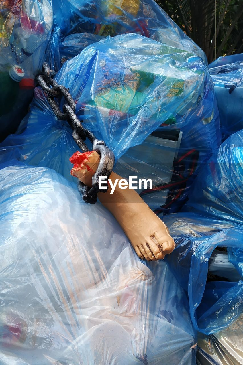 Broken mannequin on garbage