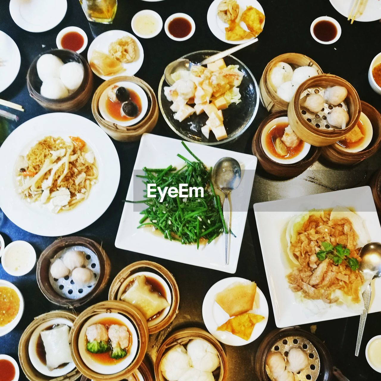food and drink, food, ready-to-eat, freshness, variation, table, healthy eating, serving size, high angle view, plate, bowl, seafood, indoors, chopsticks, rice - food staple, no people, chinese dumpling, meal, directly above, spring roll, dumpling, chinese food, close-up, dim sum, day
