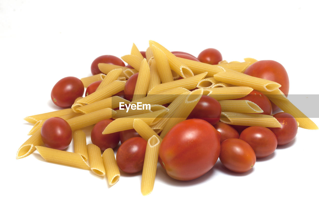 white background, food and drink, food, studio shot, freshness, pasta, healthy eating, italian food, still life, wellbeing, raw food, large group of objects, indoors, no people, tomato, close-up, vegetable, cut out, yellow, red, macaroni