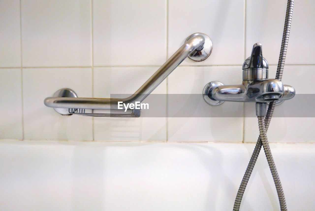 Close-up of faucet and bathtub in modern bathroom