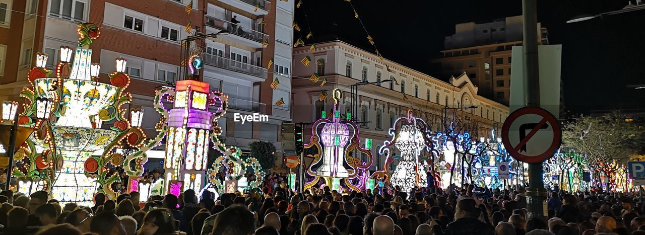 crowd, group of people, large group of people, real people, building exterior, architecture, built structure, women, city, men, lifestyles, street, adult, night, illuminated, leisure activity, celebration, togetherness, enjoyment, festival
