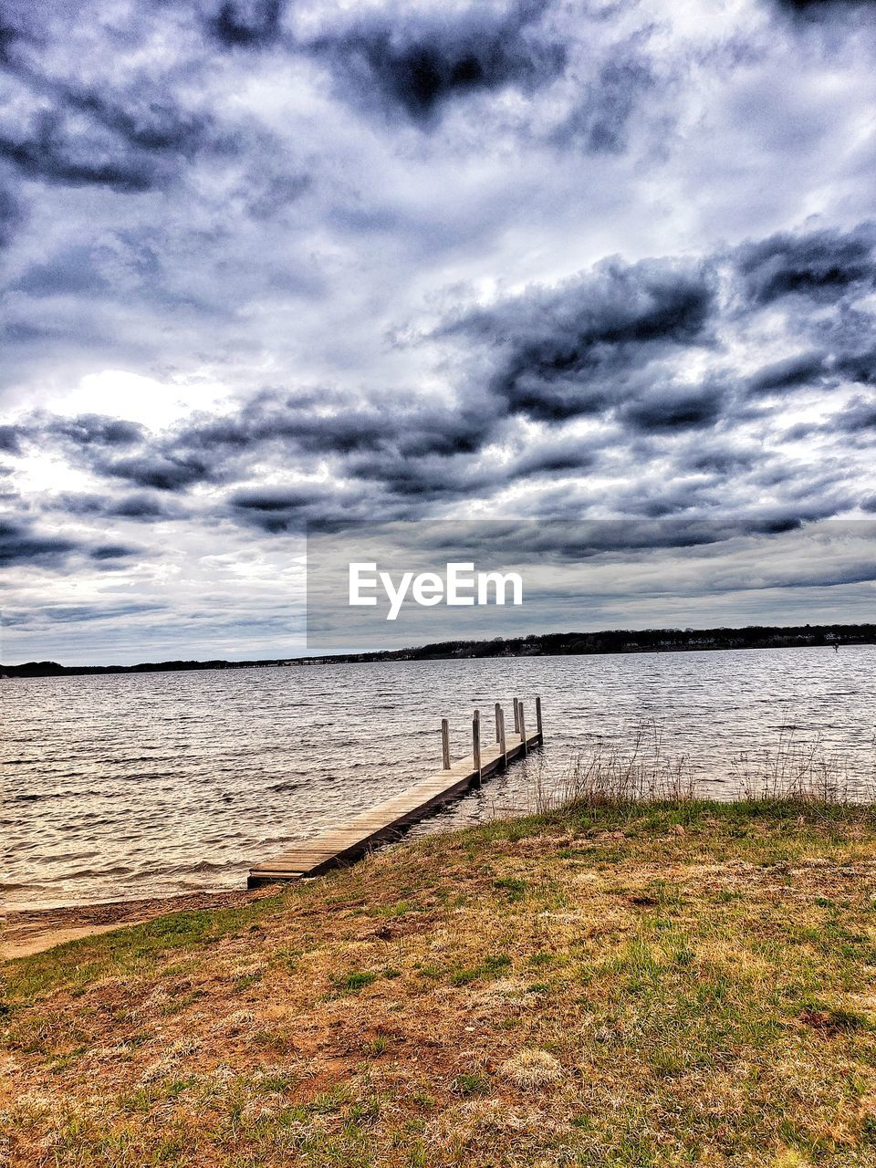 cloud - sky, sky, water, tranquility, sea, scenics - nature, tranquil scene, beauty in nature, land, nature, beach, no people, horizon, day, grass, horizon over water, wood - material, idyllic, outdoors