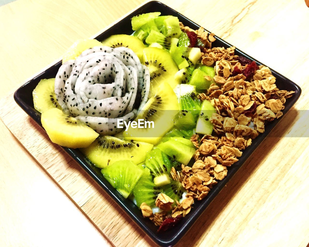 food and drink, food, freshness, table, kiwi - fruit, high angle view, fruit, no people, kiwi, indoors, healthy eating, slice, nut - food, close-up, ready-to-eat, day