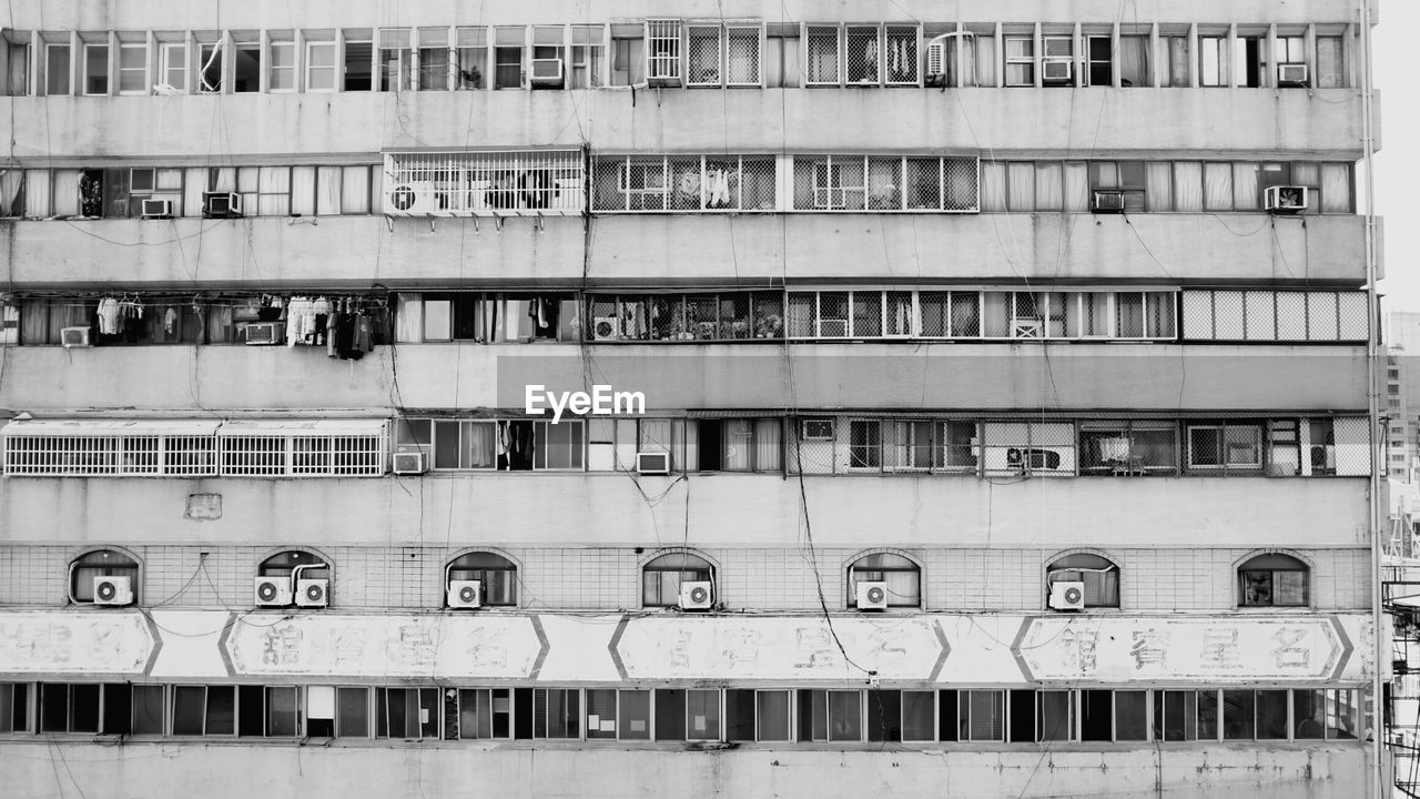 Building with windows and air conditioners