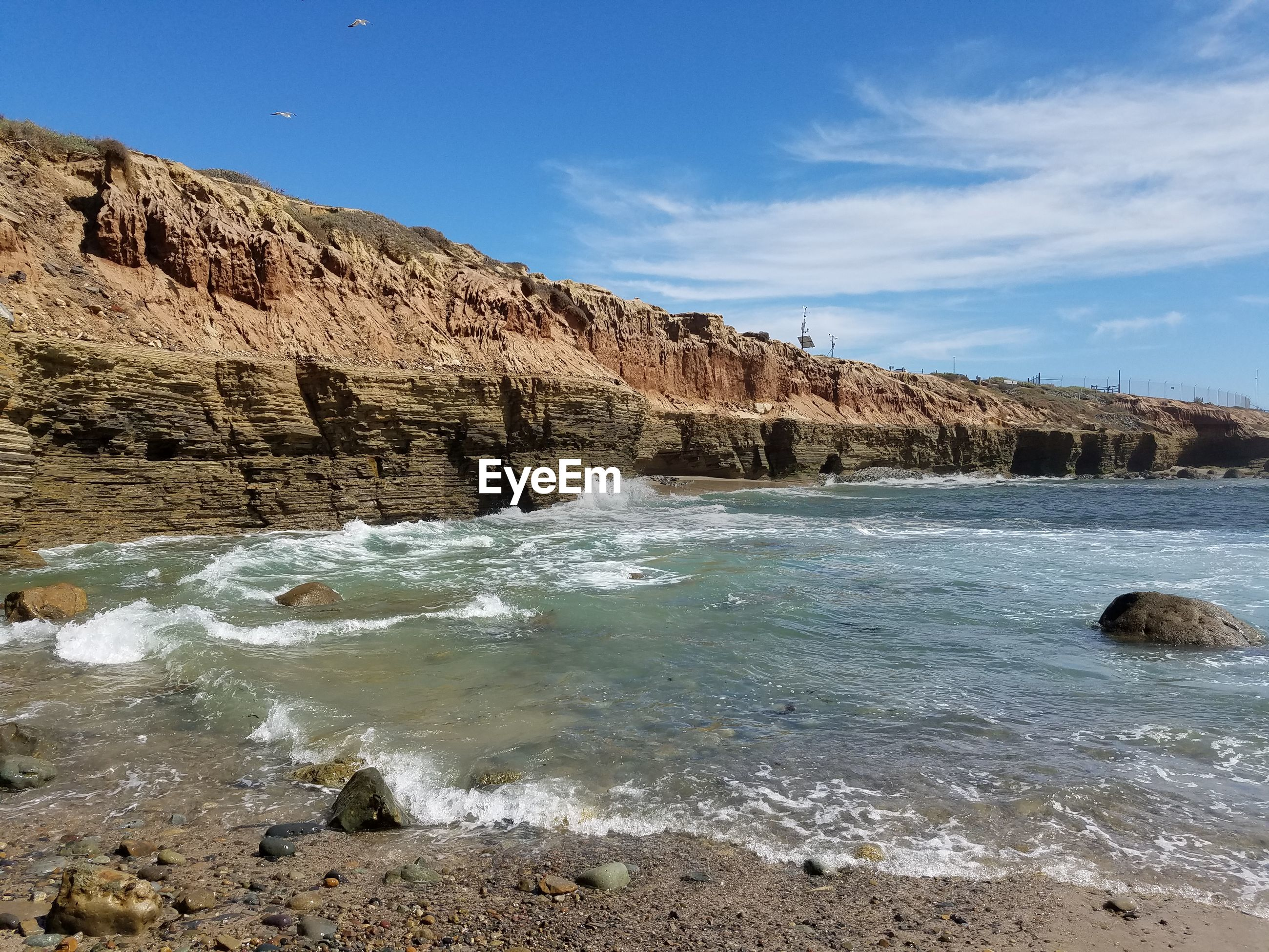 water, sea, sky, tranquil scene, scenics, tranquility, beach, rock formation, rock - object, beauty in nature, nature, blue, shore, rock, idyllic, sand, coastline, geology, cliff, day