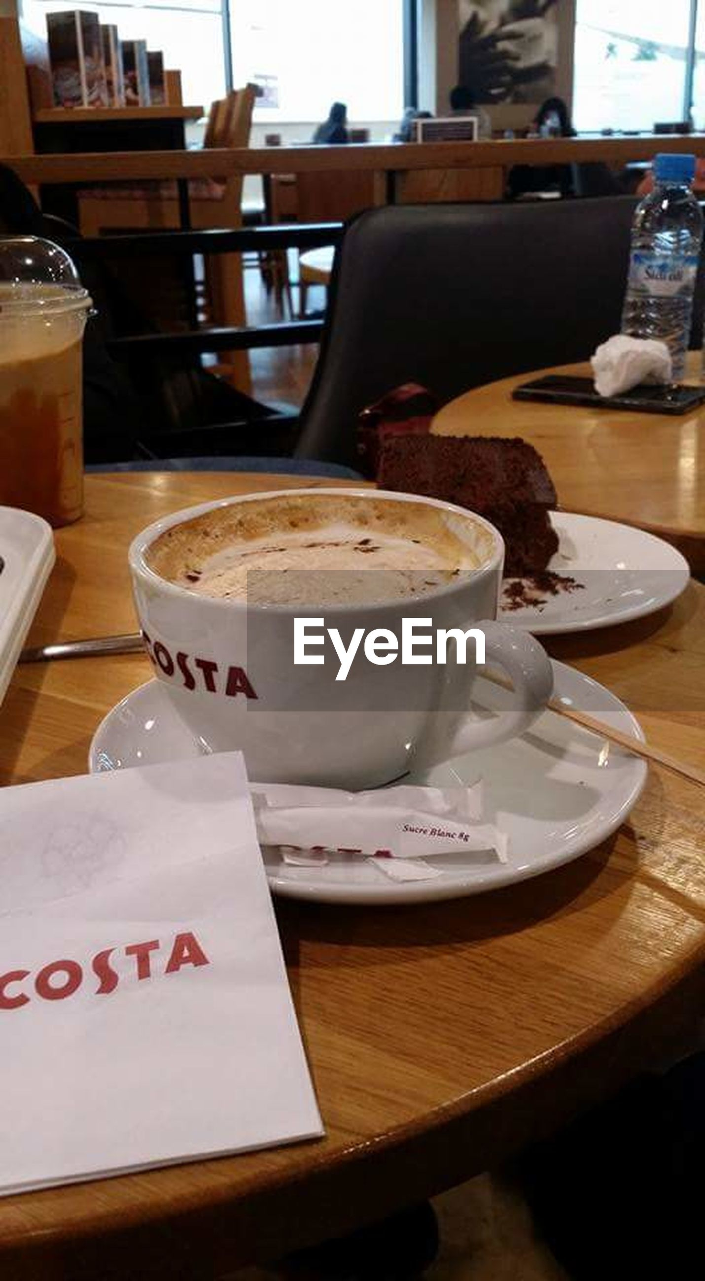table, food and drink, coffee - drink, coffee cup, restaurant, drink, refreshment, still life, indoors, cafe, no people, saucer, plate, freshness, close-up, focus on foreground, serving size, food, frothy drink, day, cappuccino, ready-to-eat