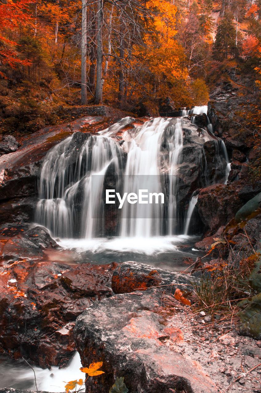 A waterfall in autumn