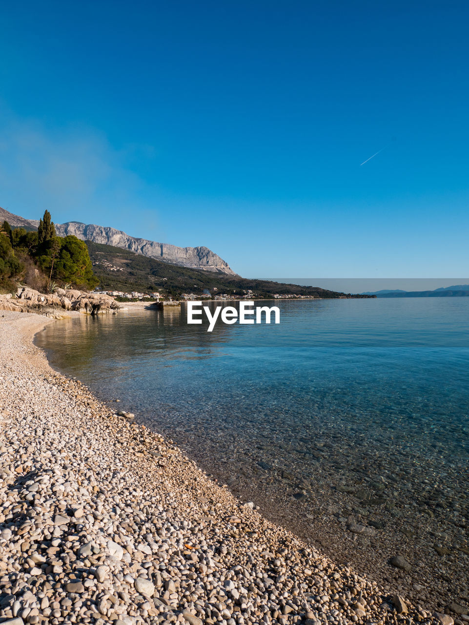 beach, sea, blue, beauty in nature, tranquil scene, nature, scenics, tranquility, water, outdoors, day, sky, no people, pebble beach
