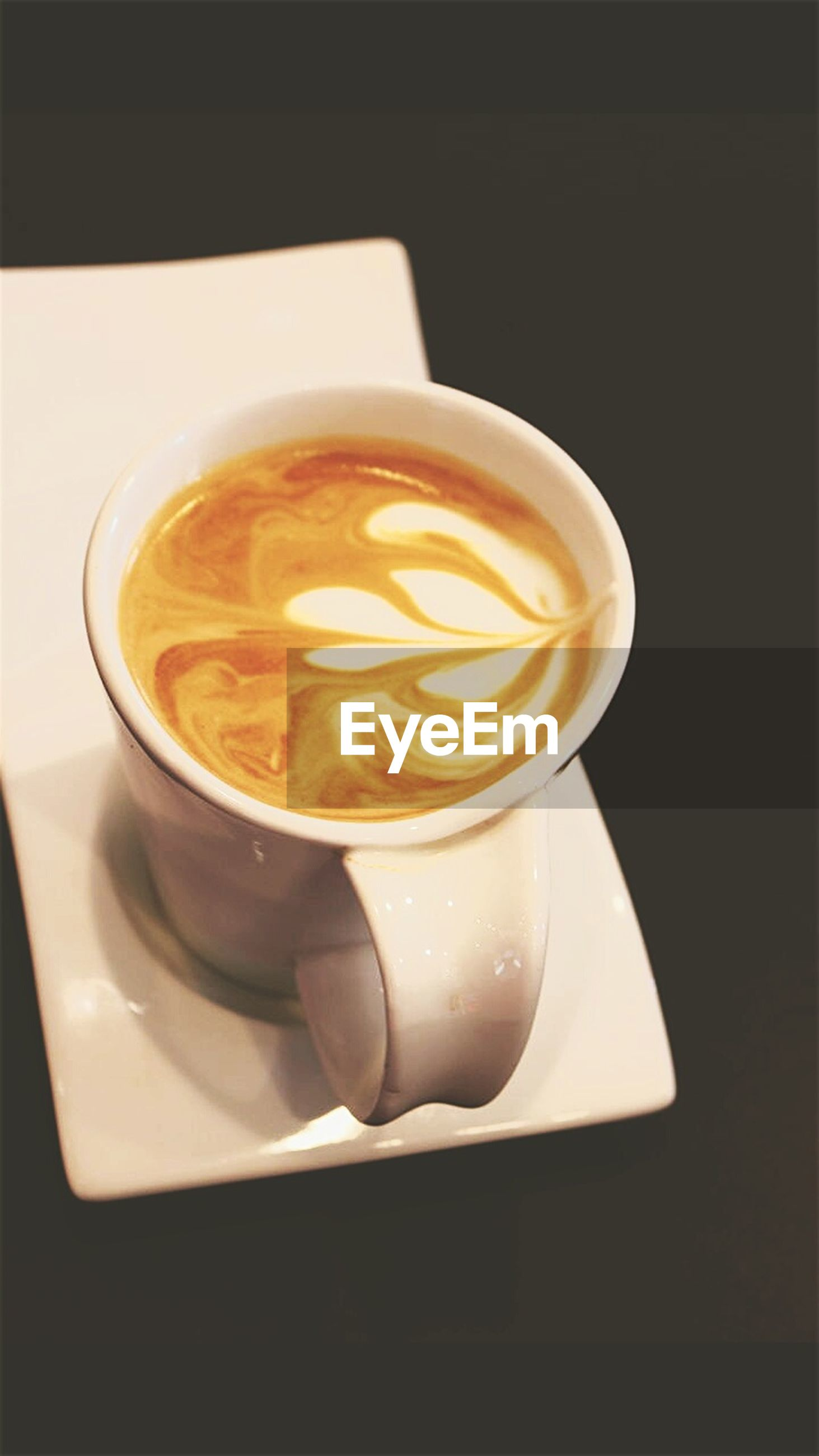 refreshment, coffee cup, drink, food and drink, coffee - drink, still life, freshness, frothy drink, cappuccino, saucer, table, indoors, high angle view, froth art, close-up, healthy eating, beverage, cup, hot drink, serving size, full, creativity, latte, no people