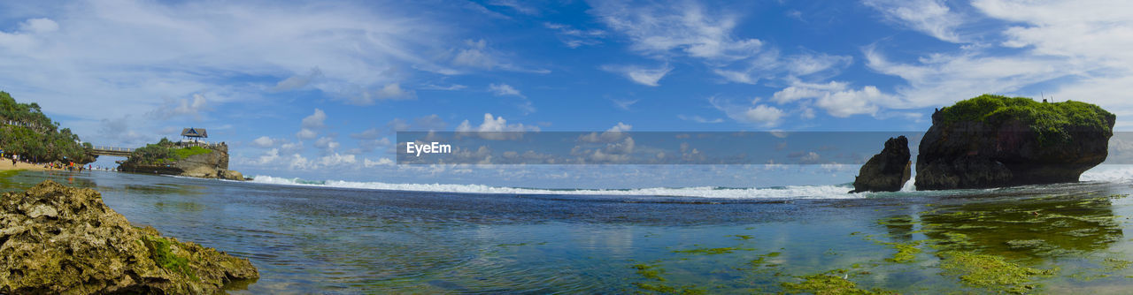 water, sky, sea, scenics - nature, beauty in nature, cloud - sky, day, tranquility, nature, tranquil scene, land, no people, beach, non-urban scene, rock, plant, blue, outdoors, idyllic