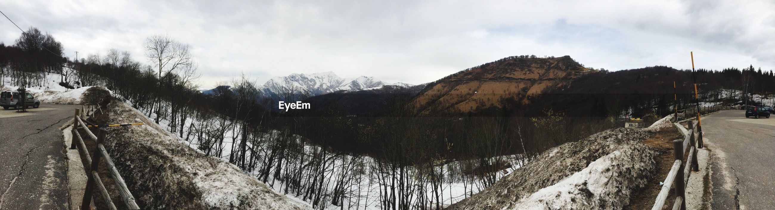 Panoramic view of street against mountains during winter