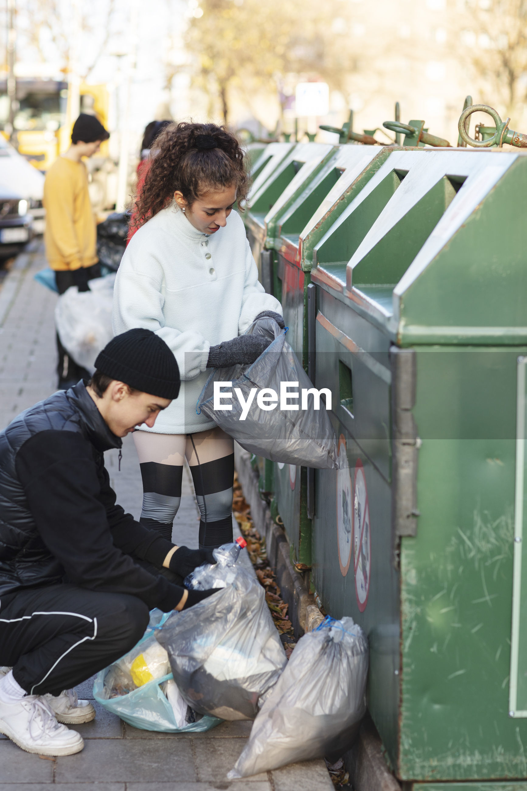 REAR VIEW OF PEOPLE IN A GARBAGE