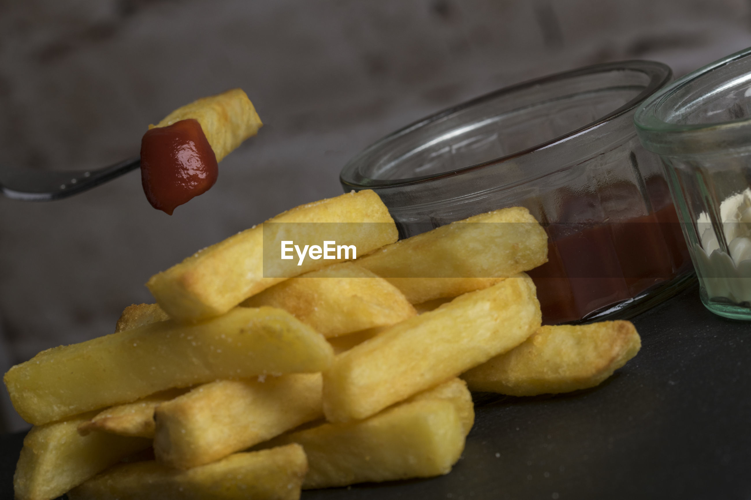 Close-up of french fries with ketchup