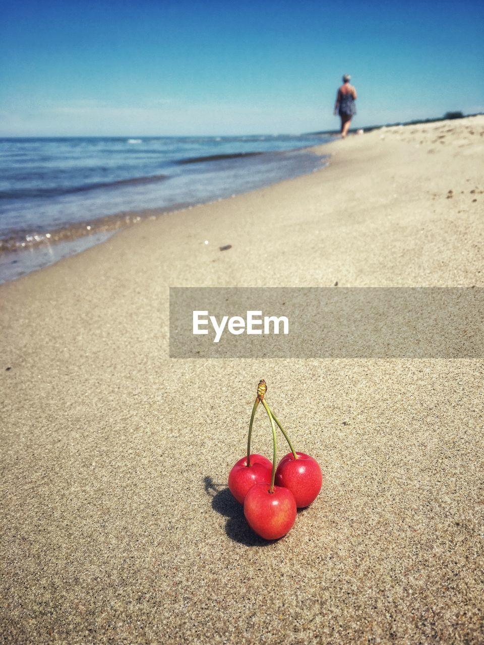 Cherries on sand at beach