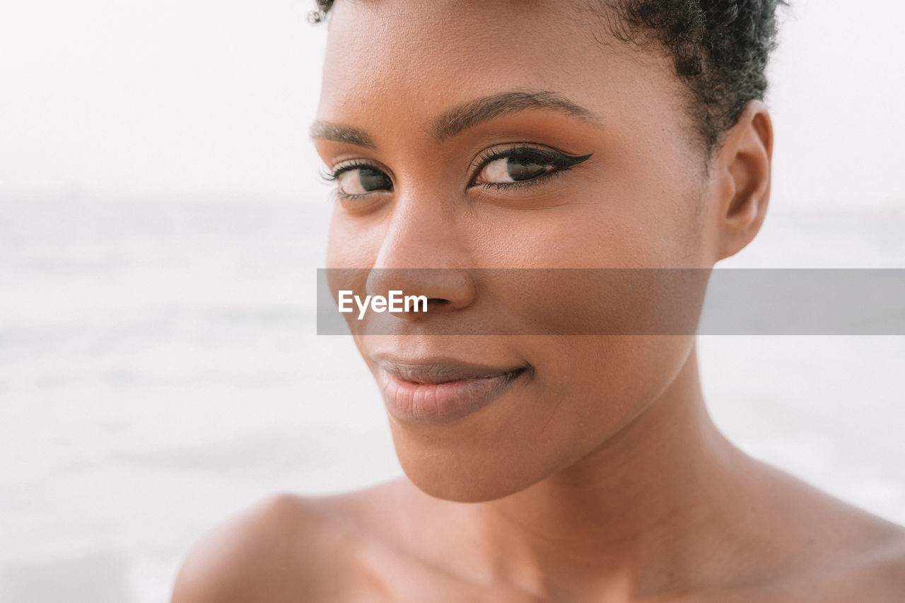 Close-up portrait of woman at beach