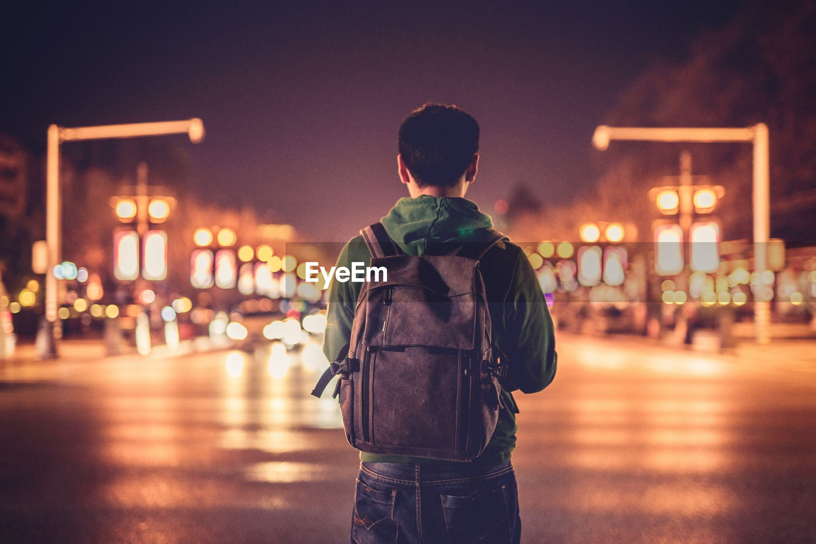 Rear view of a man in city at night
