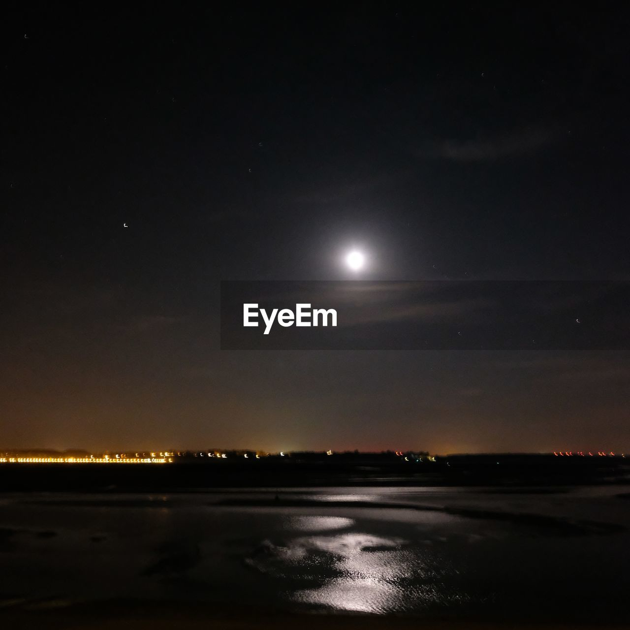 sky, night, moon, beauty in nature, water, nature, scenics - nature, tranquility, no people, tranquil scene, full moon, space, reflection, astronomy, waterfront, moonlight, cloud - sky, outdoors, illuminated, planetary moon