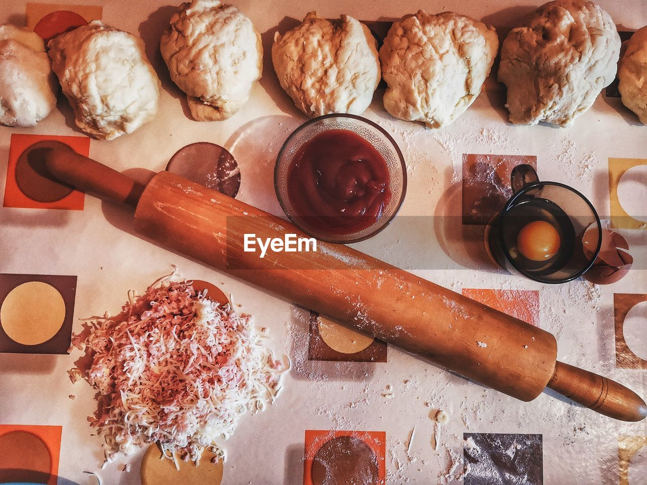 food and drink, food, freshness, indoors, kitchen utensil, still life, rolling pin, directly above, high angle view, table, preparation, no people, variation, choice, preparing food, sweet food, healthy eating, bread, container, spoon, temptation
