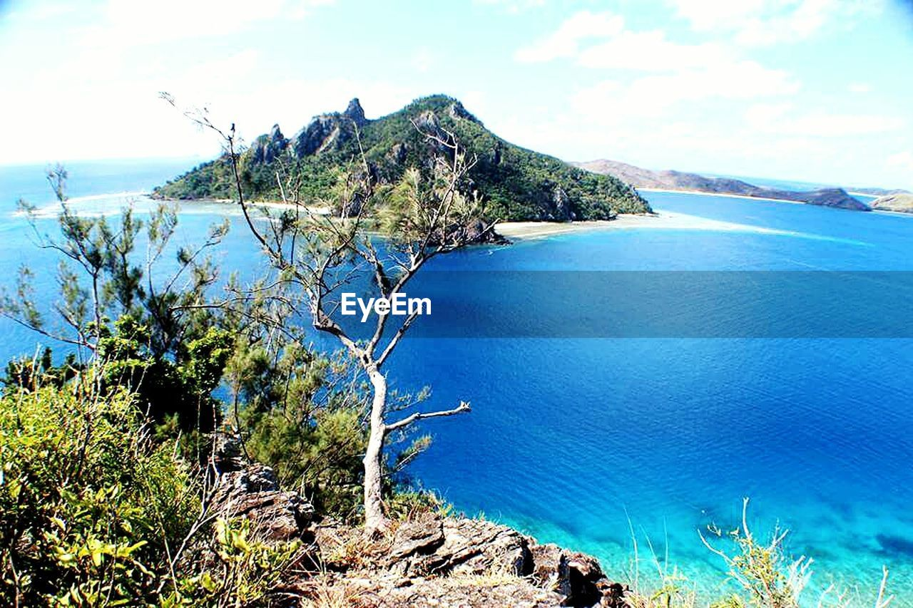 scenics, tranquil scene, sea, nature, beauty in nature, tranquility, water, sky, idyllic, mountain, no people, outdoors, rock - object, tree, day, landscape, blue, cliff, horizon over water
